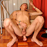 Handsome twink squats down to ride a dildo